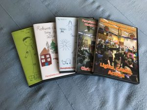 School Christmas DVDs over 5 years of productions with childrens artwork covers