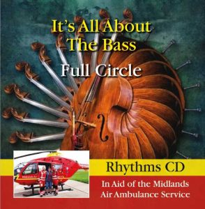 Air Ambulance rescue crew standing by a helicopter with lady recued,fund raising cd with an accoustic bass