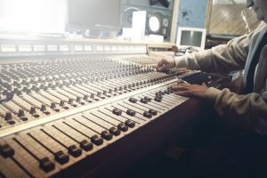 music mixing desk operated by a man