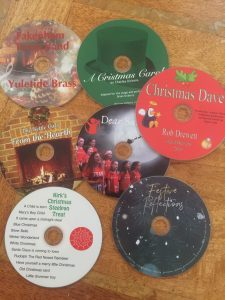 cds on a table varoius christmas prints all festive