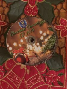 christmas tree and bauble on cd disc with festive lights