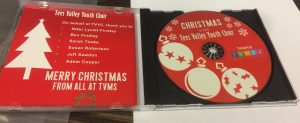 red cd with christmas baubles in plastic case