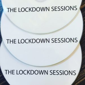 White cd disc with words printed in black LOCKDOWN music recorded during covid 19 virus
