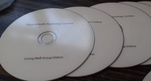 3 white cds with printing covid 19 help videos