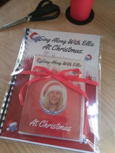 chriistmas book and dvd wrapped together with red christmas bow