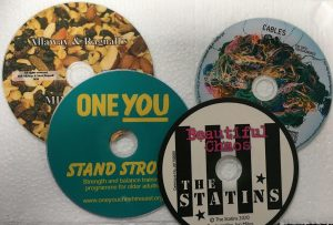 "4 colourful cds one says "" stand strong"""